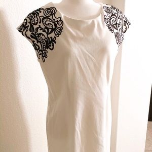 White shift dress with black floral decal sleeve